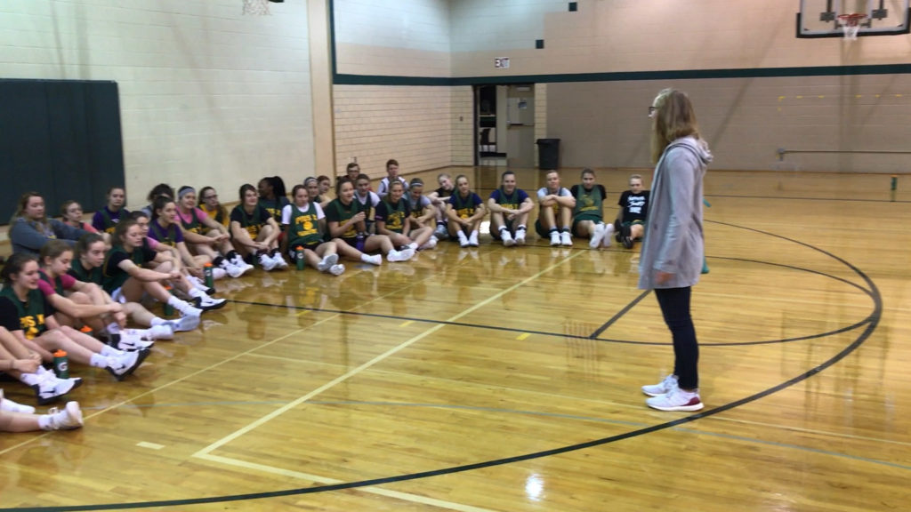 sydney townsend husker volleyball talks to student-athletes