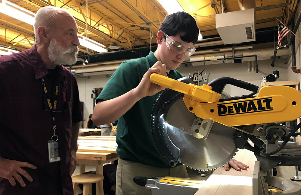 Woodworking class gets tools, first cut on miter saw