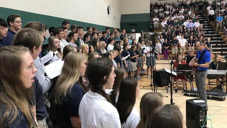 choir sings mass first day